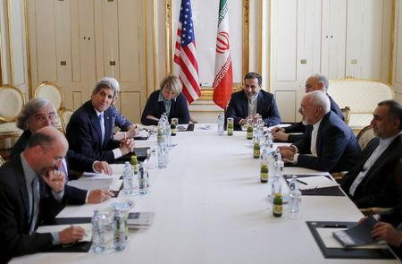 U.S. Secretary of State John Kerry meets Iranian Foreign Minister Mohammad Javad Zarif at a hotel in Vienna, Austria