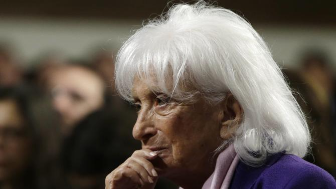 Marion Wiesel listens to her husband at a roundtable discussion on Capitol Hill in Washington
