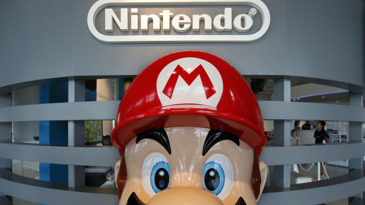 Nintendo reports loss as Wii U sales languish