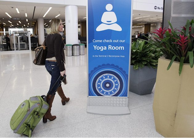In this Friday, Jan. 27, 2012 photo, traveler Maria Poole leaves San Francisco International Airport's new Yoga Room after practicing in San Francisco. The quiet, dimly lit studio officially opened la