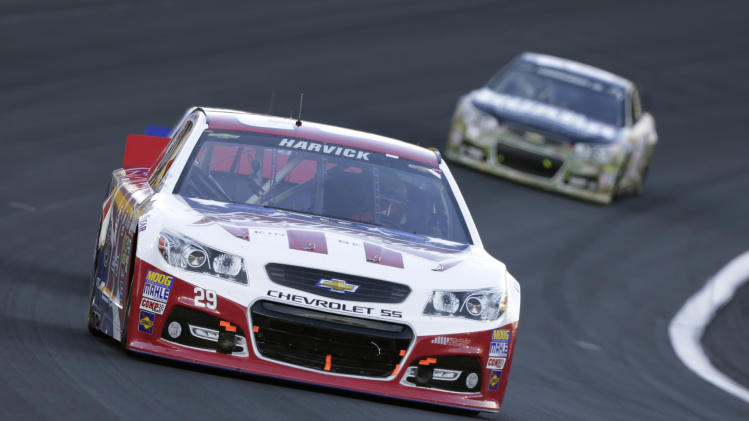Kevin Harvick races out of Turn 4 during the NASCAR Sprint Cup series Coca-Cola 600 auto race at Charlotte Motor Speedway in Concord, N.C., Sunday, May 26, 2013. (AP Photo/Chuck Burton)