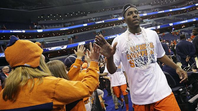 Syracuse forward Rakeem Christmas (25) high-fives fans while leaving the court after their 55-39 win over Marquette in the East Regional final in the NCAA men's college basketball tournament, Saturday, March 30, 2013, in Washington. (AP Photo/Pablo Martinez Monsivais)