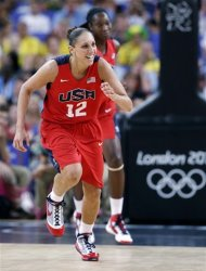 USA's Diana Taurasi smiles as she runs up court during a semifinal women's basketball game against Australia at the 2012 Summer Olympics, Thursday, Aug. 9, 2012, in London. (AP Photo/Eric Gay)