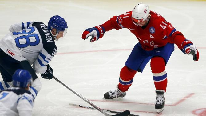 Norway's Hietanen controls the puck next to Norway's Thoresen during their ice hockey World Championship game in Ostrava