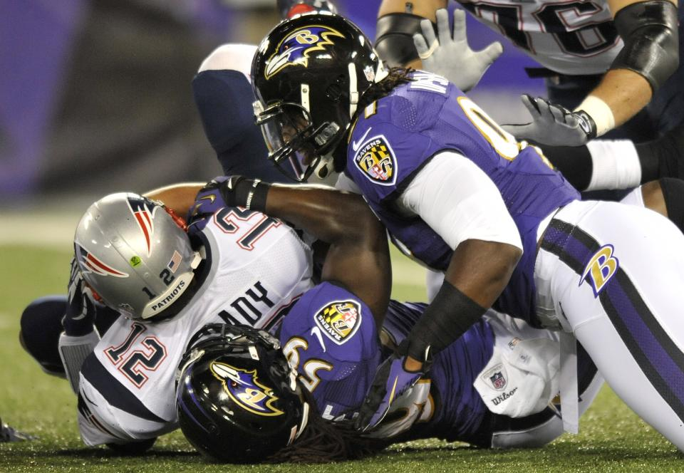 New England Patriots quarterback Tom Brady (12) is sacked by Baltimore Ravens linebacker Dannell Ellerbe (59) in the first half of an NFL football game in Baltimore, Sunday, Sept. 23, 2012. Also pictured tackling Brady is Ravens linebacker Courtney Upshaw. (AP Photo/Nick Wass)