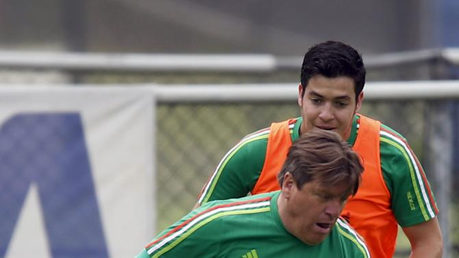 Mexico's coach Miguel Herrera plays in a soccer match with his coaching staff after a practice session in Mexico City