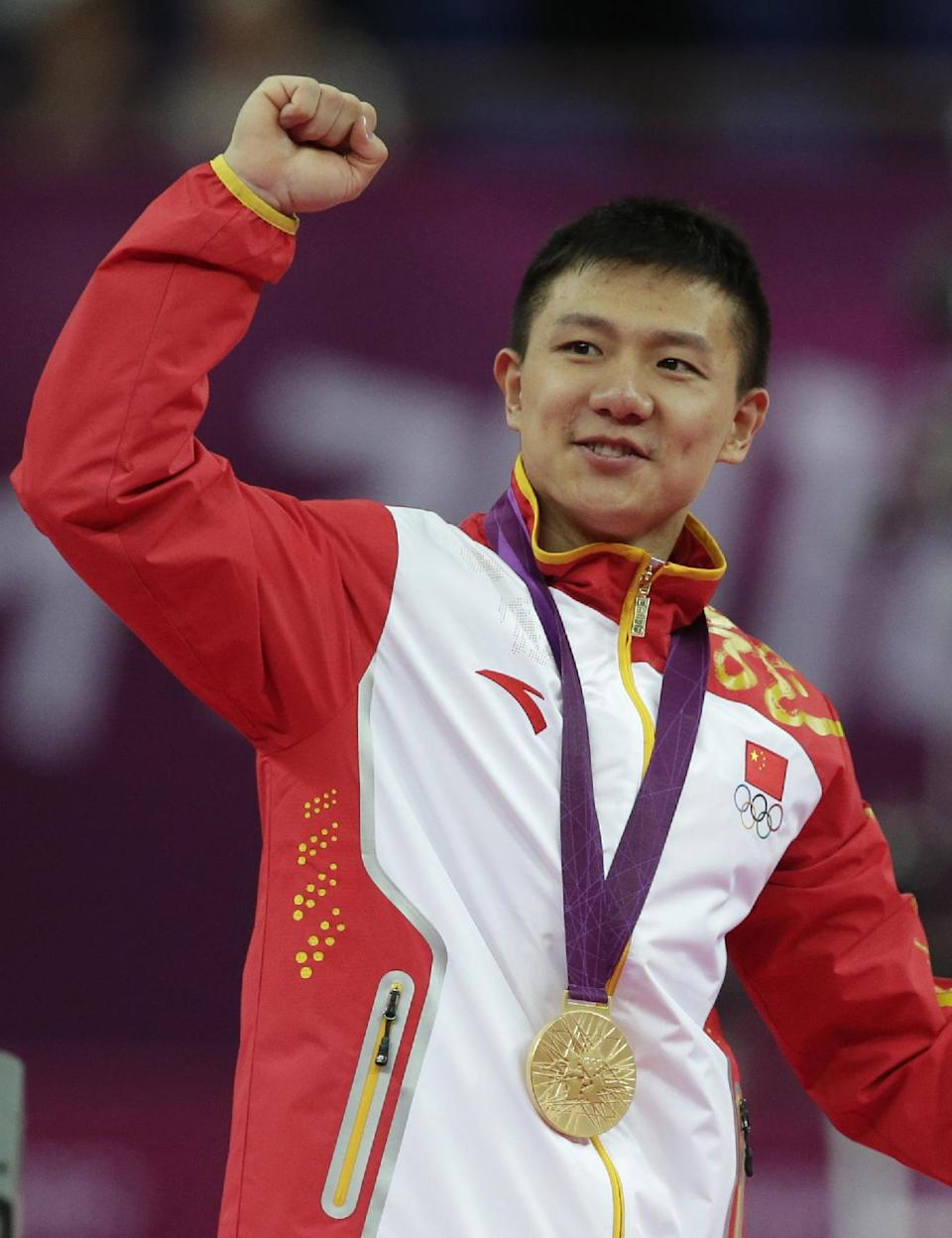 Chinese gymnast Chen Yibing celebrates his team winning the gold medal at the Artistic Gymnastic men's team final at the 2012 Summer Olympics, Monday, July 30, 2012, in London. (AP Photo/Julie Jacobson)
