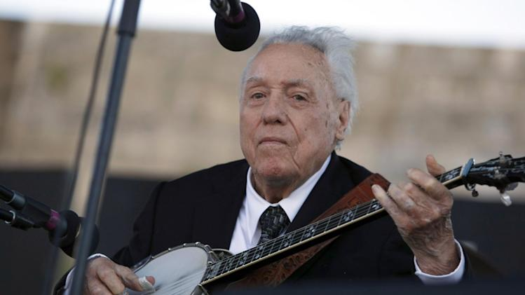FILE - In this July 30, 2011 file photo, Earl Scruggs performs at the Newport Folk Festival in Newport, R.I. Scruggs' son Gary said his father passed away Wednesday morning, March 28, 2012 at a Nashville, Tenn., hospital of natural causes. He was 88. (AP Photo/Joe Giblin, File)