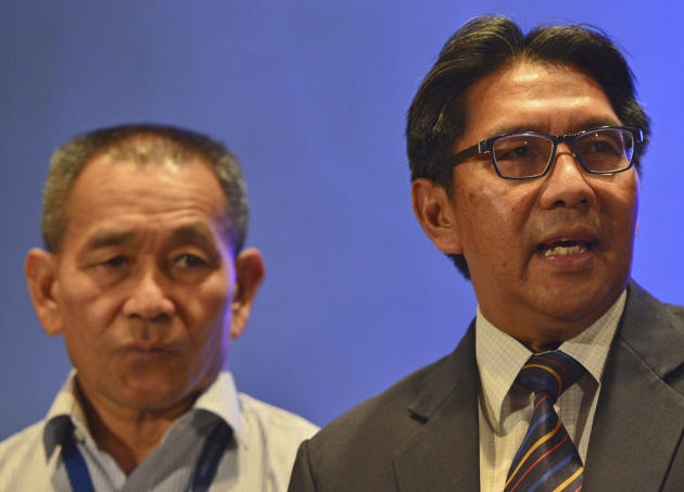 Malaysia's Department of Civil Aviation director general Azharuddin Abdul Rahman, right, speaks as Malaysia Airlines Group Chief Executive Ahmad Jauhari Yahyain listens during a press conference a