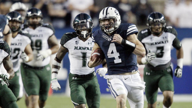 Brigham Young quarterback Taysom Hill  (4) carries the ball for a touchdown as Hawaii players pursue during the second quarter of an NCAA college football game Friday, Sept. 28, 2012, in Provo, Utah.  (AP Photo/Deseret News, Jeffrey Allred) SALT LAKE TRIBUNE OUT  PROVO OUT  MAGS OUT