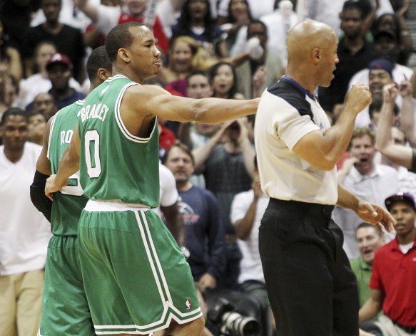 Boston Celtics&#39; Avery Bradley, center, puts his arm around Rajon Rondo, rear left, and walks him off the court as he is ejected from the game by referee Marc Davis late in the fourth quarter of Game 1 of a first-round NBA basketball playoff series against the Atlanta Hawks, Sunday, April 29, 2012, in Atlanta. The Hawks won 83-74. (AP Photo/Atlanta Journal-Constitution, Curtis Compton) MARIETTA DAILY OUT; GWINNETT DAILY POST OUT