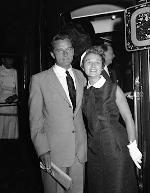 FILE - In this July 21, 1955 file photo, Sybil Williams Burton and her husband, actor Richard Burton, pose for a photo at Victoria Station in London shortly before sailing to New York on the Queen Mary. Richard Burton left Sybil for Elizabeth Taylor in 1963. She went on to become a successful nightclub owner and theater producer, and married Jordan Christopher in 1966. The New York Times has reported that Sybil Christopher died Thursday, March 7, 2013 in New York City. She was 83. (AP Photo, File)