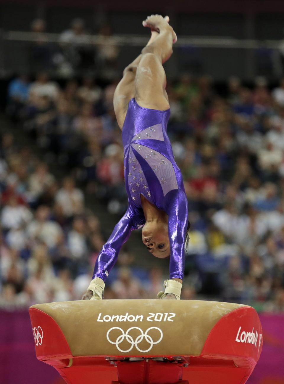 U.S. gymnast Gabrielle Douglas performs on the vault during the Artistic Gymnastics women's qualification at the 2012 Summer Olympics, Sunday, July 29, 2012, in London. (AP Photo/Gregory Bull)