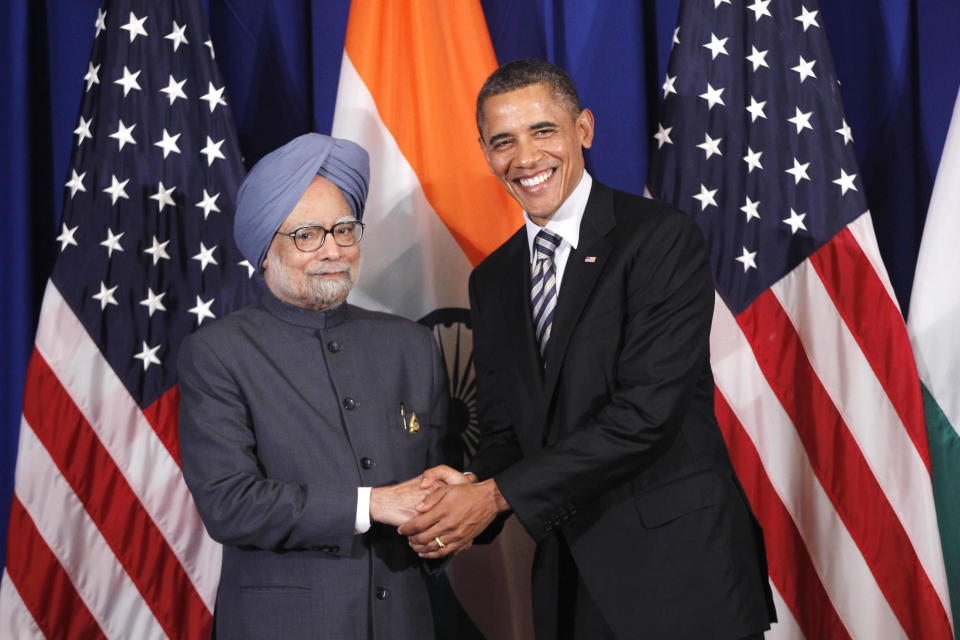 U.S. President Barack Obama meets with India's Prime Minister Manmohan Singh on the sidelines of the ASEAN and East Asia summit in Nusa Dua, on the island of Bali, Indonesia, Friday, Nov. 18, 2011. (AP Photo/Charles Dharapak)
