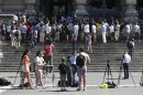 Reporters stand on the staircase of Italy's supreme court building in Rome