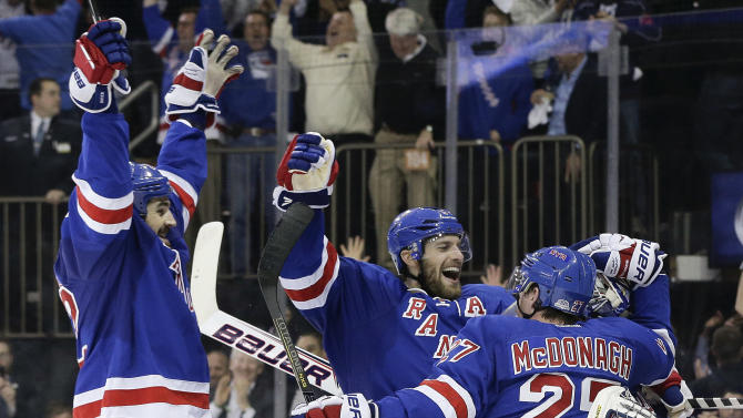 The New York Rangers celebrate after beating the Montreal Canadiens 1-0 in Game 6 of the NHL hockey Stanley Cup playoffs Eastern Conference finals, Thursday, May 29, 2014, in New York. The Rangers advance to the Stanley Cup Finals