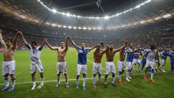 Greek players celebrate their 1-0 win at the end of  the Euro 2012 soccer championship Group A  match between Greece and Russia in Warsaw, Poland, Saturday, June 16, 2012.(AP Photo/Thanassis Stavrakis)