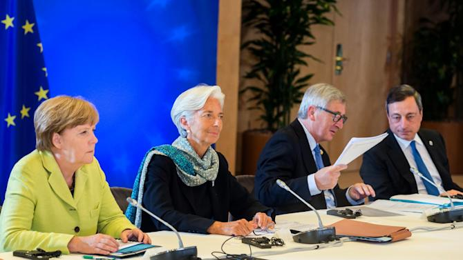 FILE - In this file photo dated Monday, June 22, 2015, from left, German Chancellor Angela Merkel, Managing Director of the International Monetary Fund Christine Lagarde, European Commission President Jean-Claude Juncker and European Central Bank Governor Mario Draghi participate in a meeting in Brussels. Following the continuing failure of the eurozone's finance ministers to cobble together a deal, a summit of the currency bloc's leaders was called. Greece made new proposals that appeared to meet with initial support. However, within a day or two, the Greek proposals were deemed insufficient by creditors, prompting a furious reaction by members of the Greek government. (AP Photo/Geert Vanden Wijngaert, FILE)