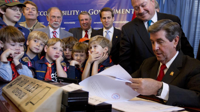 Alabama Gov. Bob Riley, right, is surrounded by lawmakers and Cub Scouts as he signs into law recently passed ethics legislation during a bill signing ceremony at the Capitol in Montgomery, Ala., Monday, Dec. 20, 2010. (AP Photo/Dave Martin)