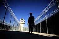 A US military policeman patrols Afghanistan's notorious Bagram prison in 2009. The United States on Friday signed a deal transferring control of the Bagram prison to the Afghan government, marking a breakthrough in negotiations on a strategic treaty between the two nations