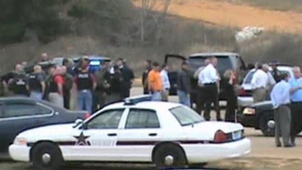 Alabama gunman kills bus driver, seizes boy