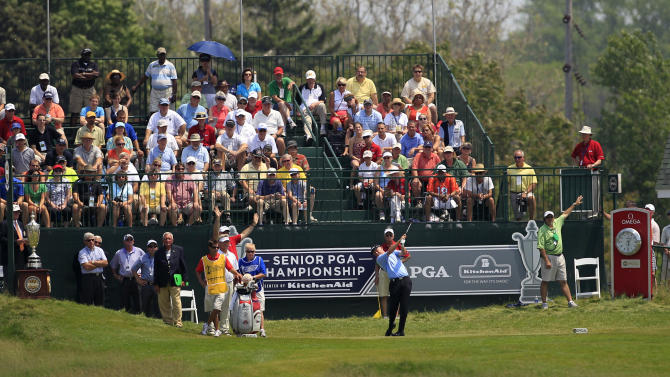 Roger Chapman drives on the first tee during the final round of the Senior PGA Championship golf tournament at the Harbor Shores Golf Club in Benton Harbor, Mich., Sunday, May 27, 2012. (AP Photo/Carlos Osorio)