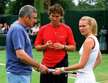 Director  Richard Loncraine , Wimbledon champion and tennis consultant Pat Cash, and Kirsten Dunst on the set of Universal Pictures' Wimbledon