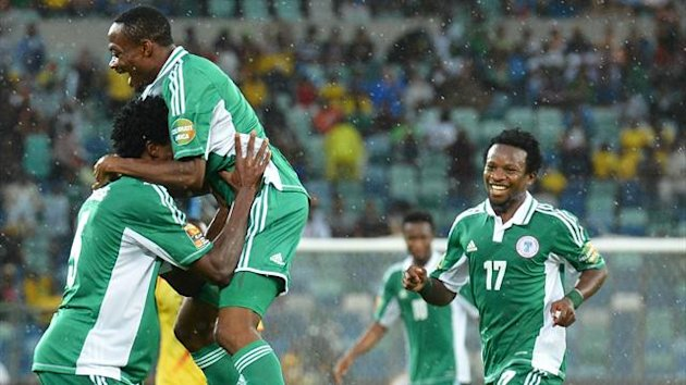 SOUTH AFRICA, Durban : Nigeria&#39;s forward Ahmed Musa (up) celebrates after scoring a goal during the 2013 African Cup of Nations semi-final football match Mali vs Nigeria on February 6, 2013 in Durban. AFP PHOTO