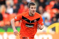 Keith Watson signed a new contract the day before Dundee United beat Queen of the South in the cup