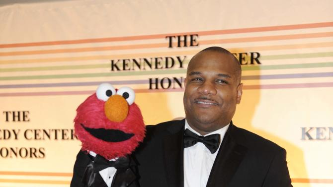 "FILE - This Dec. 4, 2011 file photo shows ""Sesame Street"" character Elmo and puppeteer Kevin Clash arrive at the Kennedy Center for the Performing Arts for the Kennedy Center Honors gala performance in Washington. Clash has taken a leave of absence from the popular kids' show following allegations that he had a relationship with a 16-year-old boy. Sesame Workshop says Kevin Clash denies the charges, which were first made in June by the alleged partner, who by then was 23. In a statement issued Monday, Nov. 12, 2012, Sesame Workshop says its investigation found the allegation of underage conduct to be unsubstantiated.  (AP Photo/Kevin Wolf, file)"