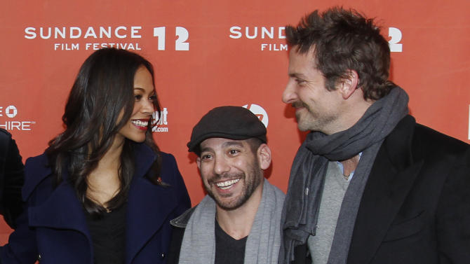 """Actress Zoe Saldana, left, co-writer and co-director Lee Sternthal, center, and actor Bradley Cooper pose at the premiere of """"The Words"""" during the 2012 Sundance Film Festival in Park City, Utah on Friday, Jan. 27, 2012. (AP Photo/Danny Moloshok)"""