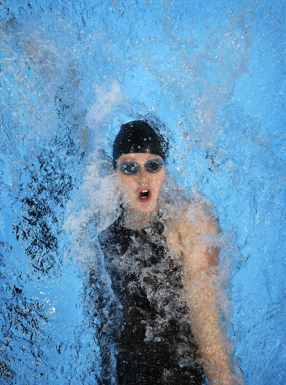 Missy Franklin swims in the women's 100-meter backstroke preliminaries at the U.S. Olympic swimming trials, Tuesday, June 26, 2012, in Omaha, Neb. (AP Photo/Mark Humphrey)
