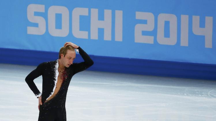 Russia's Evgeny Plyushchenko withdraws during the Figure Skating Men's Short Program at the Sochi 2014 Winter Olympics