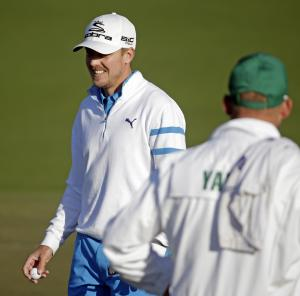 Jonas Blixt, of Sweden, walks off the seonc green after a birdie putt during the first round of the Masters golf tournament Thursday, April 10, 2014, in Augusta, Ga. (AP Photo/Chris Carlson)