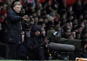 Manchester United's manager Moyes instructs his team during their English Premier League soccer match against Swansea City in Manchester