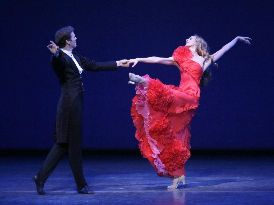 "This Thursday, Sept. 20, 2012 image released by the New York City Ballet shows Maria Kowroski and Charles Askegard in ""Sophisticated Lady"" at the New York City Ballet fall gala, with costumes designed by Valentino Garavani in New York. (AP Photo/New York City Ballet, Paul Kolnik)"