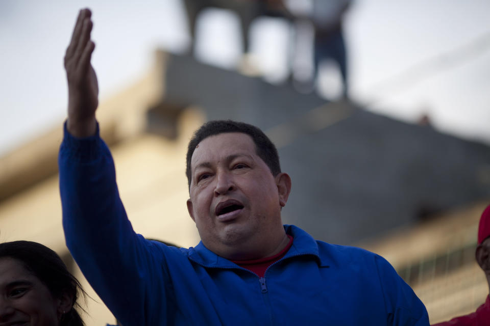 Venezuela's President Hugo Chavez waves to supporters during a campaign rally in Barquisimeto, Venezuela, Tuesday, Oct. 2, 2012. Chavez will run for re-election against opposition candidate Henrique Capriles on Oct. 7. (AP Photo/Rodrigo Abd)