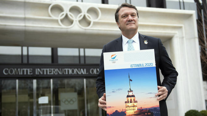 Hasan Arat, Istanbul 2020 Bid Chairman and the Vice President of the Turkish National Olympic Committee, poses for photographers in front of the IOC headquarters before they submit their candidature bid for 2020 Istanbul Olympic summer games at the International Olympic Committee, IOC, headquarters in Lausanne, Switzerland, Monday, Jan. 7, 2013. The International Olympic Committee announced that Istanbul, Tokyo and Madrid have made it on to the short list of cities bidding to host the 2020 Olympic Games. (AP Photo/Keystone, Jean-Christophe Bott)