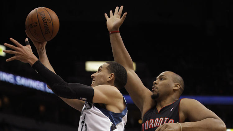 Minnesota Timberwolves guard Kevin Martin (23) pushes up to the basket past Toronto Raptors forward Chuck Hayes (44) in the second half of an NBA basketball game, Sunday, March 9, 2014, in Minneapolis. The Raptors won 111-104. (AP Photo/Stacy Bengs)