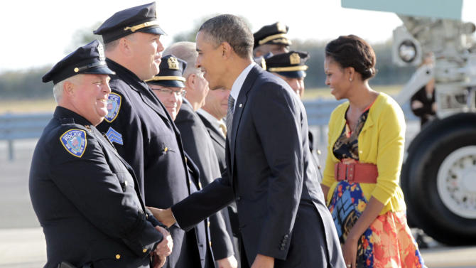 President Barack Obama and first lady Michelle Obama greet Port Authority Police Officers during their arrival at JFK International Airport, Monday, Sept., 19, 2011, in New York. (AP Photo/Pablo Martinez Monsivais)