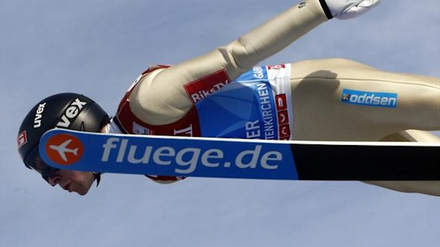 Norway's Anders Jacobsen soars through the air during the trial jump for the second jumping of the 61st four-hills ski jumping tournament in Garmisch-Partenkirchen, southern Germany, January 1, 2013 (Reuters)