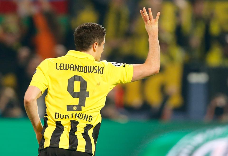 Dortmund's Robert Lewandowski, from Poland, celebrates after scoring his fourth goal during the Champions League semifinal first leg soccer match between Borussia Dortmund and Real Madrid in Dortmund, Germany, Wednesday, April 24 2013. (AP Photo/Frank Augstein)