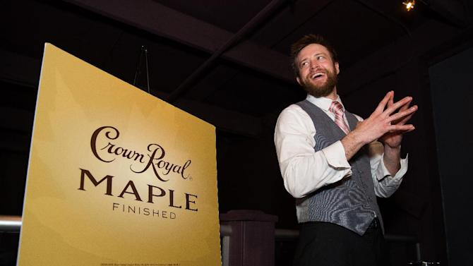 Mixologist Troy Sidle speaks during the Charleston Crown Royal Maple Finished Launch Party at Social Restaurant + Wine Bar Wednesday, January 30, 2013, in Charleston, S.C.  (Mic Smith / AP Images for Crown Royal)