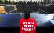 A woman pauses for reflection at the 9/11 Memorial during ceremonies marking the 12th anniversary of the 9/11 attacks on the World Trade Center in New York. September 11, 2013. REUTERS/Alejandra Villa/Pool (CANADA - Tags: ANNIVERSARY DISASTER)