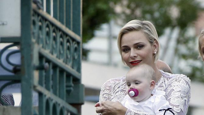 "Princess Charlene of Monaco holds Princess Gabriella as she arrives to take part in the traditional ""Pique Nique Monegasque"" (Monaco's picnic) in Monaco"