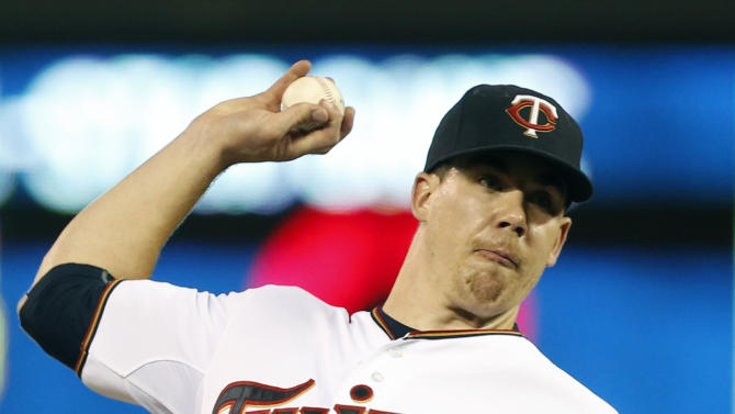 Minnesota Twins pitcher Trevor May throws against the Baltimore Orioles in the 10th inning of a baseball game, Monday, July 6, 2015, in Minneapolis. The Twins won 4-2 on a two-run, walk off home run by Brian Dozier. May picked up the win. (AP Photo/Jim Mone)