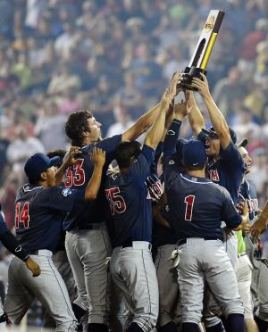 Arizona players hoist the trophy after defeating South Carolina 4-1 in Game 2 to win the NCAA College World Series baseball finals in Omaha, Neb., Monday, June 25, 2012. (AP Photo/Eric Francis)