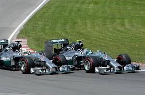 Formula One - Hamilton 'cooked' his brakes in early battle with Rosberg
