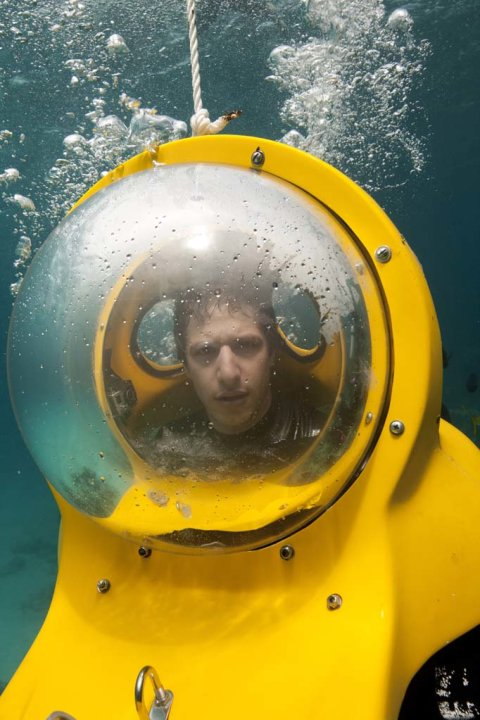"Andy Samberg, Chief Shark Officer, in an underwater scooter at The Sand Bowl, Nassau, Bahamas on ""Shark City."""