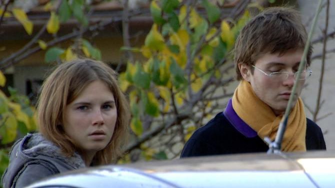 "FILE - In this Friday Nov. 2, 2007 file photo Amanda Marie Knox, left, and Raffaele Sollecito, stand outside the rented house where 21-year-old British student Meredith Kercher was found dead Friday, in Perugia, Italy. The state's prosecutor is arguing his case that an appeals court should reinstate the guilty verdict against U.S. exchange student Amanda Knox for the grisly 2007 murder of her roommate. Prosecutor Alessandro Crini said Monday that Italy's highest court had ""razed to the ground"" the Perugia appellate court's 2011 decision to throw out the guilty verdicts, freeing Knox and co-defendant Raffaele Sollecito. (AP Photo/Stefano Medici)"